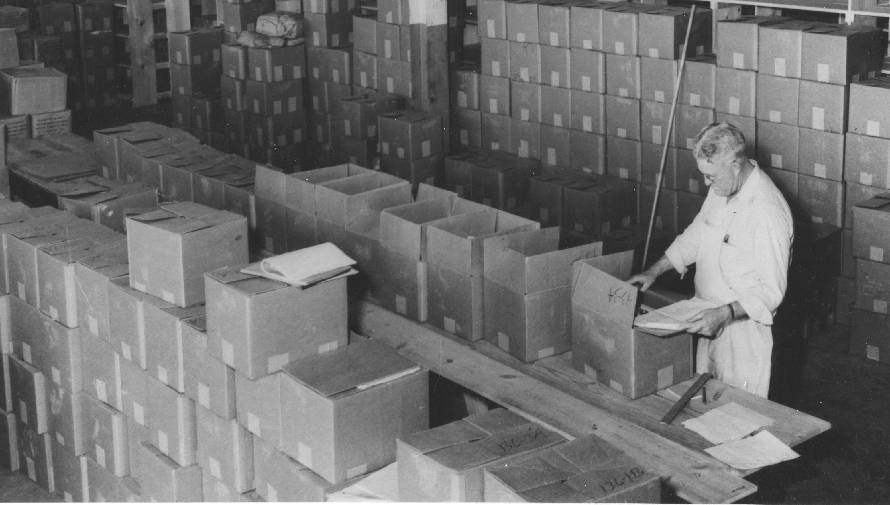 64-na-1-285-inspecting-records-in-alexandria-virginia-frc-aug-29-1952-cropped