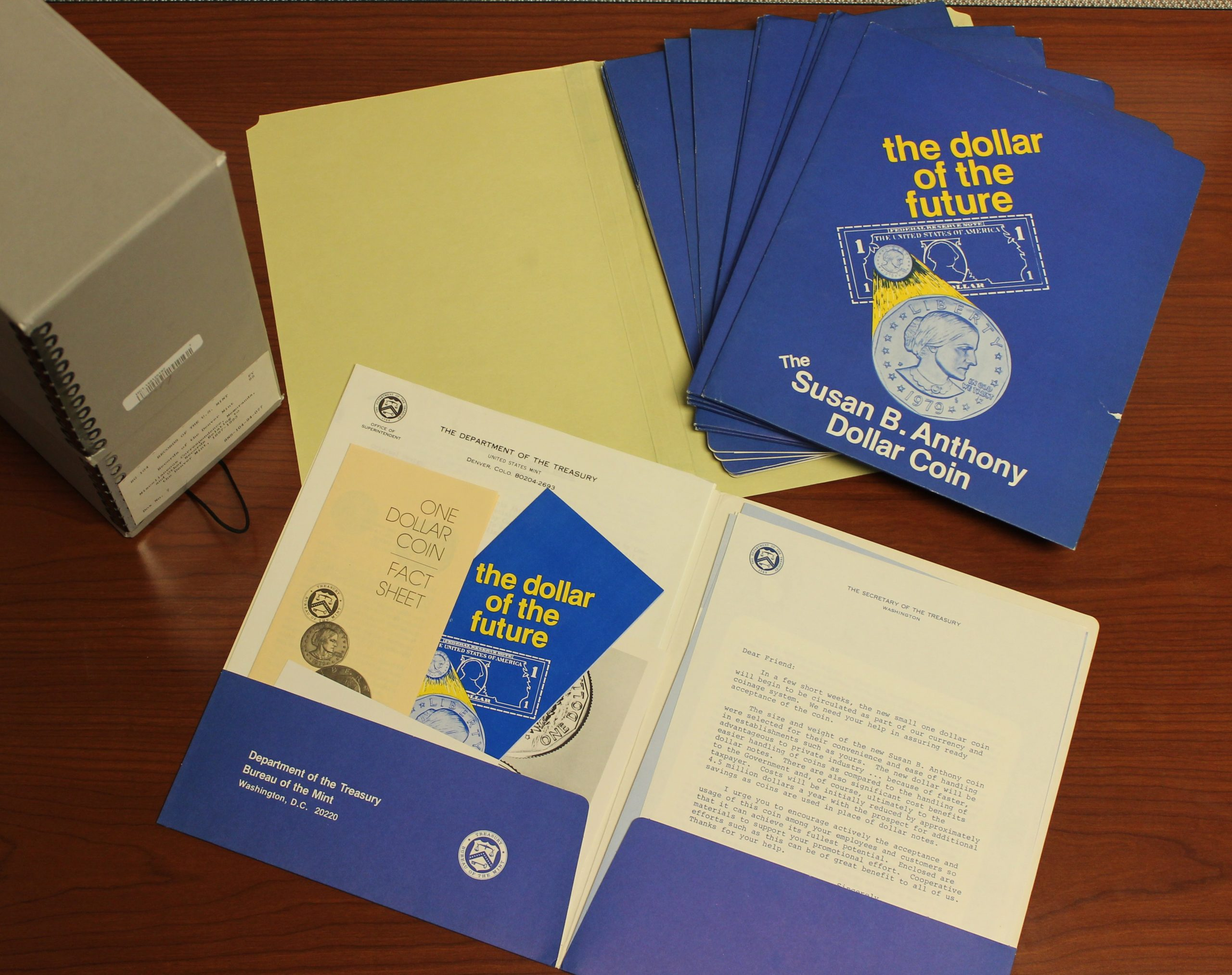 blue folders containing promotional text and pamphlets