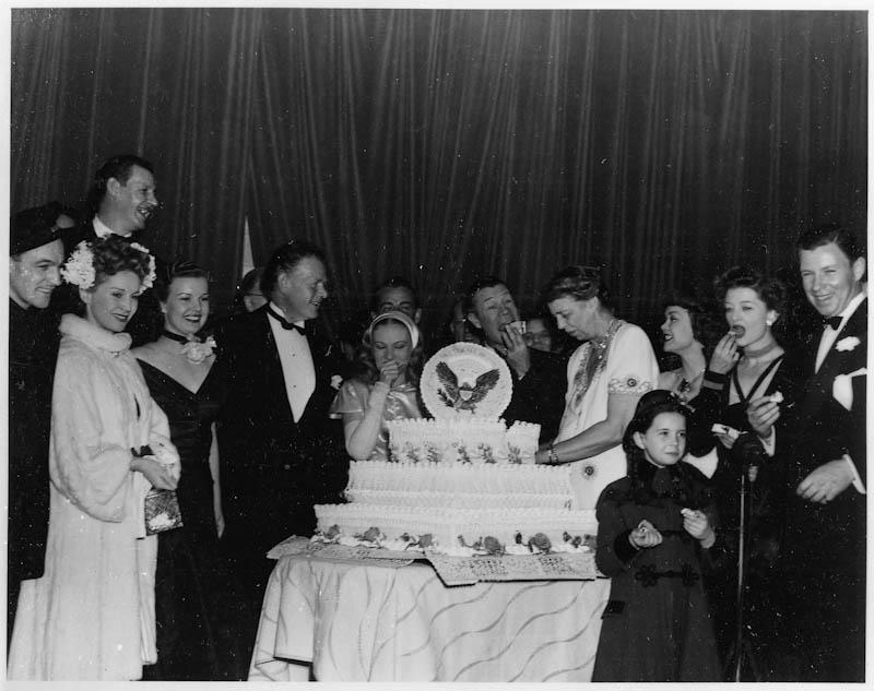 Eleanor Roosevelt at Franklin D. Roosevelt's birthday celebration with Myrna Loy, others