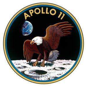 patch for Apollo 11, an eagle with laurel branch in its talons landing on moon