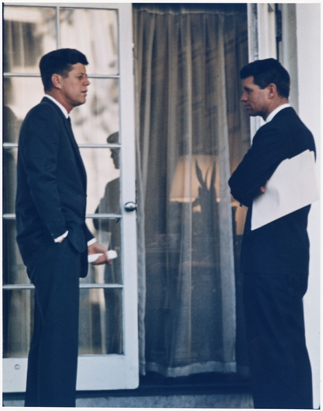 President Kennedy and Robert Kennedy standing facing each other